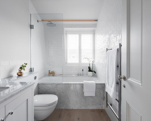 Example Of A Danish Bathroom Design In London With Shaker Cabinets White