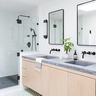 Inspiration for a mid-sized transitional master white tile and ceramic tile cement tile floor and green floor alcove shower remodel in New York with flat-panel cabinets, light wood cabinets, white walls, an integrated sink, concrete countertops and a hinged shower door