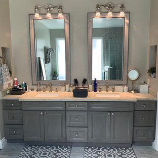 Inspiration for a large traditional master bathroom in Orange County with recessed-panel cabinets, grey cabinets, a freestanding tub, a corner shower, a one-piece toilet, gray tile, slate, green walls, marble floors, an undermount sink, marble benchtops, grey floor, a hinged shower door, yellow benchtops, a niche, a shower seat, a double vanity and a built-in vanity.