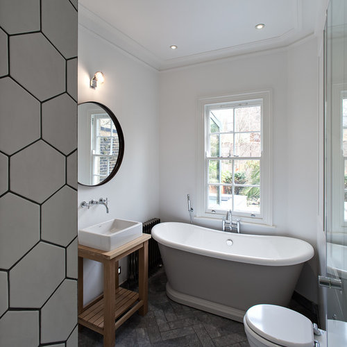 photo of a contemporary and modern bathroom in london with a vessel sink medium wood - Bathroom Ideas London