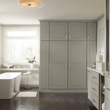Tall bathroom with floor-to-ceiling cabinets and a console bathtub