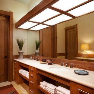 This is an example of a contemporary bathroom in Los Angeles with flat-panel cabinets and medium wood cabinets.
