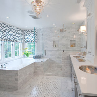 Elegant white tile alcove shower photo in San Francisco with an undermount sink and shaker cabinets