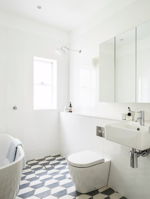 Example of a coastal black and white tile walk-in shower design in Sydney  with