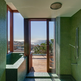 Inspiration for a tropical wet room bathroom in Sydney with a corner tub, green tile, mosaic tile, mosaic tile floors, green floor and an open shower.