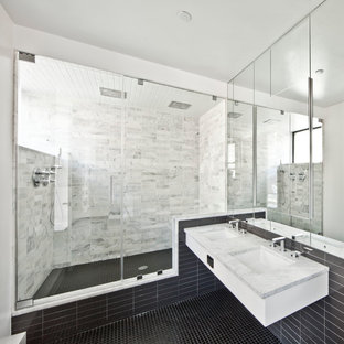 Trendy gray tile mosaic tile floor and black floor alcove shower photo in New York with an undermount sink