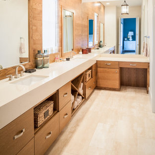 Example of a large trendy master white tile and mirror tile light wood floor and beige floor bathroom design in Houston with flat-panel cabinets, light wood cabinets, beige walls, an integrated sink, a hinged shower door and engineered quartz countertops