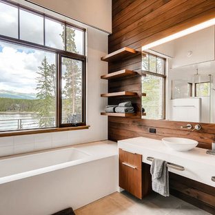 Freestanding bathtub - large contemporary master white tile beige floor freestanding bathtub idea in Denver with flat-panel cabinets, white cabinets, brown walls, a vessel sink and solid surface countertops
