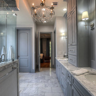 Inspiration for a large timeless master white tile and marble tile marble floor bathroom remodel in Houston with raised-panel cabinets, gray cabinets, white walls, an undermount sink and marble countertops