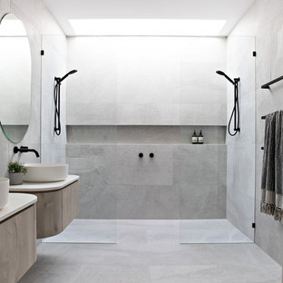Inspiration for a contemporary bathroom in Gold Coast - Tweed with flat-panel cabinets, light wood cabinets, gray tile, a vessel sink, grey floor, an open shower, beige benchtops and a double shower.