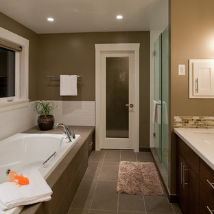 Inspiration for a large contemporary kids' brown tile and mosaic tile brown floor and ceramic floor bathroom remodel in Vancouver with an undermount sink, flat-panel cabinets, dark wood cabinets, beige walls, engineered quartz countertops, a hinged shower door and white countertops
