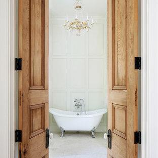 Elegant white tile claw-foot bathtub photo in New Orleans