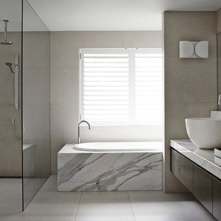 Example of a large minimalist marble tile bathroom design in Melbourne with a vessel sink, flat-panel cabinets, dark wood cabinets and marble countertops