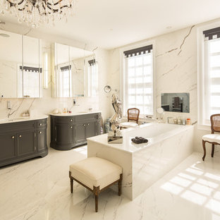 Design ideas for a large bathroom in London with a console sink, freestanding cabinets, dark wood cabinets and a submerged bath.