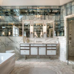 Imagen de cuarto de baño principal, contemporáneo, grande, con lavabo bajoencimera, armarios tipo mueble, puertas de armario blancas, encimera de mármol, bañera exenta, ducha empotrada, baldosas y/o azulejos blancos, baldosas y/o azulejos con efecto espejo, paredes blancas y suelo con mosaicos de baldosas