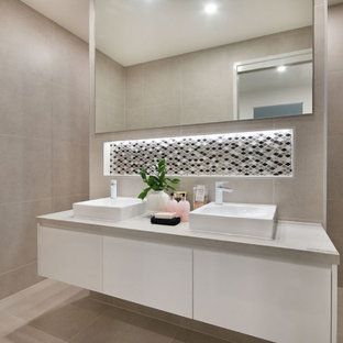 Mid-sized contemporary 3/4 bathroom in Gold Coast - Tweed with flat-panel cabinets, white cabinets, gray tile, porcelain tile, porcelain floors, a vessel sink, beige floor, grey benchtops and a niche.