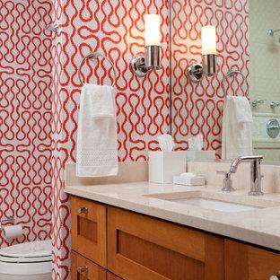 Inspiration pour une salle de bain ethnique avec un lavabo encastré, un placard à porte shaker, des portes de placard en bois brun et un mur multicolore.
