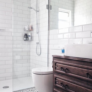 Trendy white tile and ceramic tile multicolored floor and terrazzo floor bathroom photo in London with brown cabinets, a one-piece toilet and white walls
