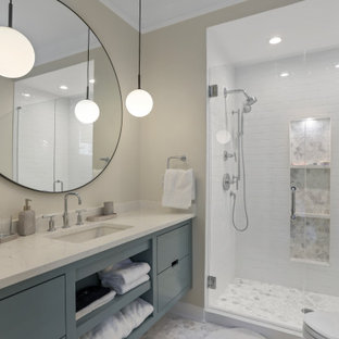 This is an example of a mid-sized contemporary 3/4 bathroom in Atlanta with flat-panel cabinets, turquoise cabinets, an open shower, white tile, subway tile, beige walls, ceramic floors, granite benchtops, white floor, a hinged shower door, white benchtops and an undermount sink.