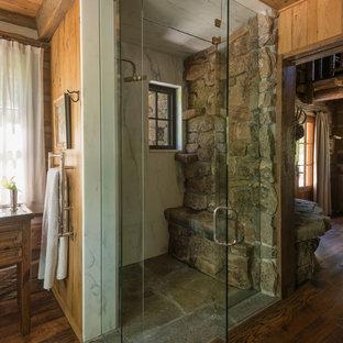 Bathroom - rustic dark wood floor bathroom idea in Other with a hinged shower door