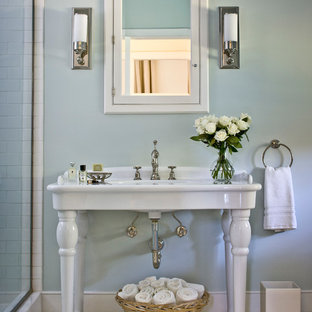 Example of a mid-sized country master white tile and subway tile mosaic tile floor bathroom design in New York with a console sink and blue walls