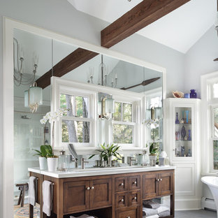 Mid-sized transitional master white tile and ceramic tile gray floor bathroom photo in Orange County with dark wood cabinets, gray walls, an undermount sink, a hinged shower door, white countertops and furniture-like cabinets