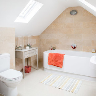 Medium sized nautical bathroom in Buckinghamshire with beige tiles, ceramic tiles, beige walls, ceramic flooring, a wall-mounted sink, grey floors, a built-in bath and a two-piece toilet.