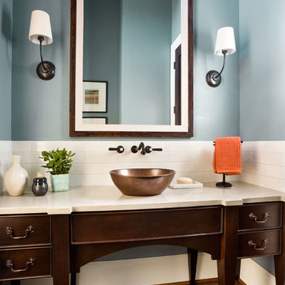 Example of a large transitional 3/4 white tile and ceramic tile medium tone wood floor bathroom design in Portland with a vessel sink, furniture-like cabinets, dark wood cabinets, blue walls, quartz countertops and beige countertops