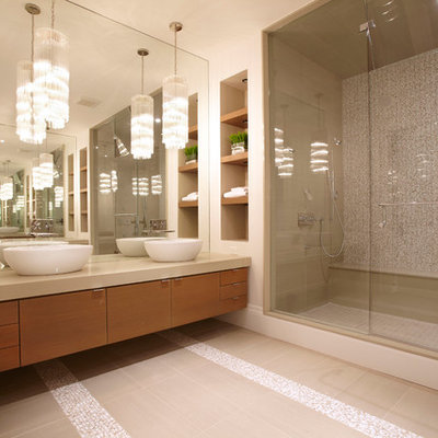 Bathroom - contemporary master beige tile bathroom idea in Toronto with a vessel sink, flat-panel cabinets and medium tone wood cabinets