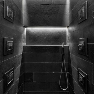 Photo of an urban family bathroom in London with a walk-in shower, black tiles, slate tiles, black walls, slate flooring, black floors and an open shower.