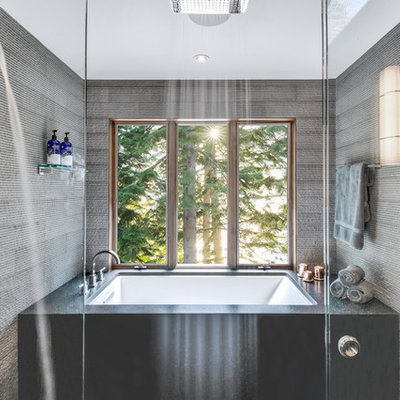 Large mountain style master gray tile and stone tile ceramic tile and gray floor bathroom photo in Other with furniture-like cabinets, brown cabinets, an undermount tub, a one-piece toilet, gray walls, a vessel sink, granite countertops and gray countertops