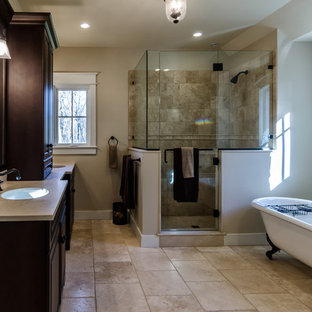 Bathroom - large contemporary master beige tile and stone tile travertine floor bathroom idea in New York with an integrated sink, furniture-like cabinets, dark wood cabinets, granite countertops and white walls