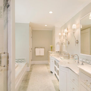 Elegant white tile bathroom photo in Boston with a vessel sink, white cabinets, flat-panel cabinets and white countertops