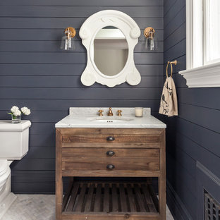 Inspiration for a transitional 3/4 mosaic tile floor and white floor bathroom remodel in New York with furniture-like cabinets, medium tone wood cabinets, a two-piece toilet, blue walls and an undermount sink