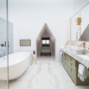 Contemporary ensuite bathroom in London with a vessel sink, flat-panel cabinets, marble worktops, white walls, marble flooring, green cabinets and marble tiles.