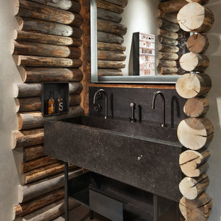 Example of a mountain style dark wood floor and brown floor bathroom design in Other with beige walls and a trough sink