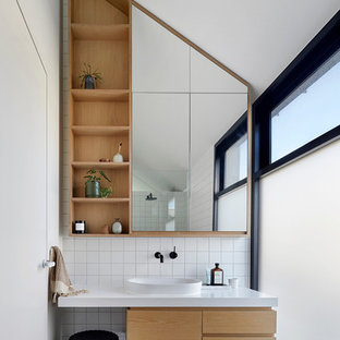 Inspiration for a contemporary master bathroom in Melbourne with white tile, white walls, ceramic floors, engineered quartz benchtops, grey floor, flat-panel cabinets, medium wood cabinets, a vessel sink and white benchtops.