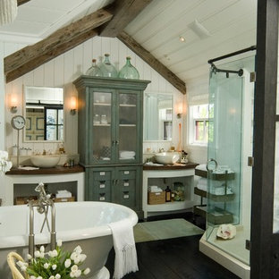 Cottage freestanding bathtub photo in Miami with a vessel sink, open cabinets and white cabinets