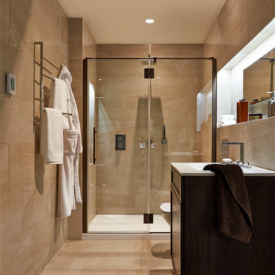 Inspiration for a mid-sized modern master beige tile and ceramic tile ceramic tile bathroom remodel in Chicago with flat-panel cabinets, dark wood cabinets, a one-piece toilet, beige walls and a drop-in sink