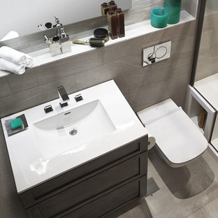 Example of a small minimalist master gray tile and ceramic tile ceramic tile bathroom design in Chicago with furniture-like cabinets, dark wood cabinets, a one-piece toilet, gray walls and an integrated sink