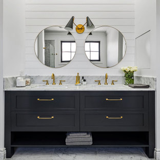 This is an example of a country bathroom in Other with shaker cabinets, black cabinets, white walls, an undermount sink, grey floor, grey benchtops, a double vanity, a built-in vanity and planked wall panelling.
