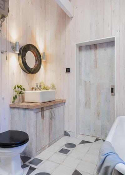 Rustic Bathroom by Unique Homestays