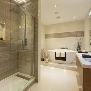 Design ideas for a contemporary ensuite bathroom in Hertfordshire with a freestanding bath, a walk-in shower, porcelain tiles, porcelain flooring and an open shower.