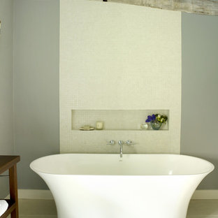 Design ideas for a medium sized rural ensuite bathroom in London with a freestanding bath, white tiles, mosaic tiles, grey walls and porcelain flooring.
