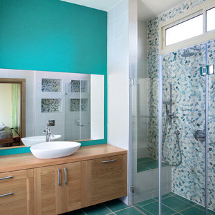 Contemporary bathroom in Mexico City with a vessel sink and turquoise floors.