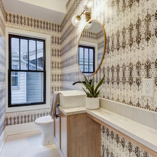 Bathroom - small craftsman ceramic tile and white floor bathroom idea in Oklahoma City with flat-panel cabinets, white cabinets, a two-piece toilet, multicolored walls, a vessel sink, quartz countertops and white countertops