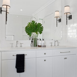 Design ideas for a mid-sized contemporary 3/4 bathroom in Gold Coast - Tweed with shaker cabinets, white cabinets, white tile, an undermount sink, grey floor, grey benchtops, a double vanity and a built-in vanity.