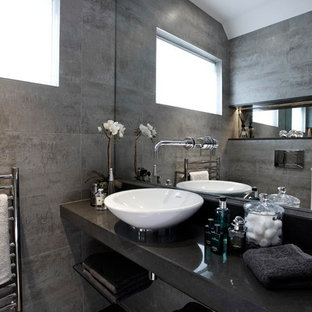 Inspiration for a contemporary bathroom in London with a vessel sink.