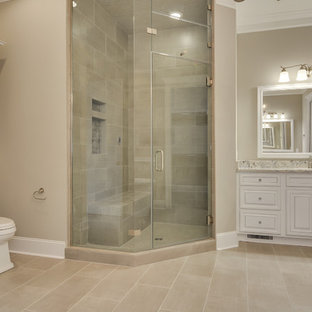 Inspiration for a large country master beige tile and porcelain tile porcelain floor bathroom remodel in Atlanta with raised-panel cabinets, white cabinets, a one-piece toilet, gray walls, a drop-in sink and granite countertops