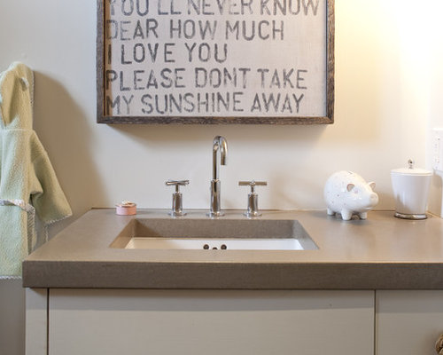 bathroom idea in san francisco with an undermount sink and white cabinets